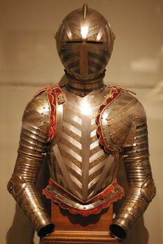 """Italy (Master Mariano """"The Armorer""""), ~1605.    Originally made for Cosimo II de' Medici, Grand Duke of Tuscany.    The blunt visor, assymetrical pauldrons, and lack of lance rest or tassets (thigh protection) indicate that this armour was intended for tournaments on foot over a barrier, which was popular sport for boys as well as men."""