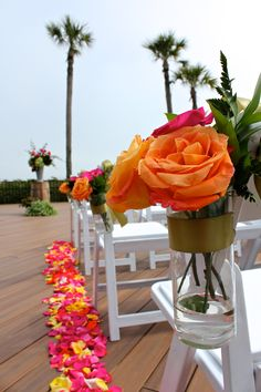 Piles of colorful rose petals create the outline of an aisle on the Oceanfront Deck. Design: Kelli Corn Weddings & Events | Location: The Oceanfront Deck of The Westin Hilton Head Island Resort & Spa #westinhhi #colorful #wedding #aisle #beach