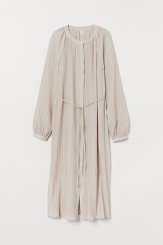 Calf-length straight-cut tunic in woven pleated fabric. Buttons at front and narrow ties at waist. Long raglan sleeves with narrow buttoned cuffs. Slits at sides. Abaya Fashion, Fashion Outfits, Red Fashion, Rustic Dresses, Belted Cardigan, Calf Length Skirts, Pleated Fabric, Oversized Jacket, Dresses