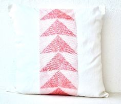 Ivory white decorative throw pillows in art silk with geometric triangles embroidered in aqua pink sequins. This beautiful handmade white and pink pillow has intricately embellished glass beads in a g