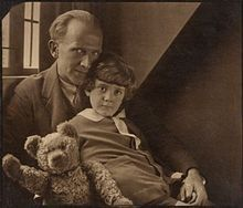 Milne with his son Christopher Robin and Pooh Bear, at Cotchford Farm, their home in Sussex. Photo by Howard Coster, 1926