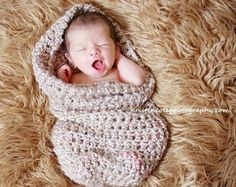 Cute  snuggly!  I have a white sheepskin rug in baby's room, but where do I find an adorable blanket like that?
