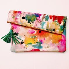 water color fold over flap clutch with contrast tassel -- just that pop of color your outfit needs!