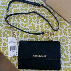 Authentic Michael Kors PURSE LG phone crossbow haircalf, black 3 pockets inside with one side pocket. Michael Kors Bags Shoulder Bags