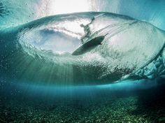 Photographing Surfers From Under the Waves at Teahupoo, Tahiti