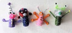 Pipe cleaner aliens...CUTE. C had a grand time with this. I used the hot glue gun, of course.