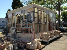 Homemade greenhouse from reclaimed windows and other materials at Omega Salvage in Berkeley, CA