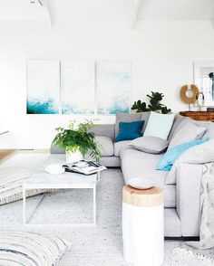 They say blue is a calming colour, but this is just next level. The amazing artwork by @chriswarnes (from @otomys) is the focal point of this relaxed living space found in @darrenanddeanne's family home. Why not take a load off and tour the rest of their home via the link in our bio.⠀⠀ ⠀⠀ Styling - @darrenanddeanne⠀⠀ Photography - @armellehabib