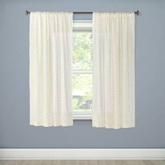 Let the light filter through the Xhil Metallic Dot Sheer curtain panel. This drapery panel has a see-through quality and golden dots to add interest.