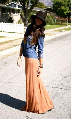 Love the easy summery look of a maxi skirt, a denim shirt, long hair and a big floppy boho hat...