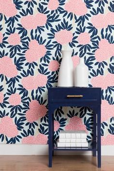 Our most loved pattern now in wallpaper. Classic navy and poppy pink on a soft aqua background combine to create a chic palette with serious style. Paired with bright whites, navys, and a myriad of ne