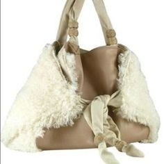 I just discovered this while shopping on Poshmark: KONTESSA LARGE CREAM AND BROWN ITALIAN HANDBAG. Check it out!  Size: Large
