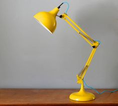 Yellow desk lamp is cute color for decoration your room. Desk lamps can be mounted on desks and often have movable arms that allow the light source Home Lighting Design, Cool Lighting, Yellow Desk Lamps, Yellow Table, Great Wedding Presents, Anglepoise Lamp, Adjustable Table, Desk Light, Bedside Lamp