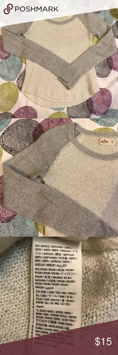 Shiny sweater Super cute Hollister sweater. It has shiny fibers  within the sweater. No holes rips or stains. 40% Acrylic, 30% Nylon, 23% Wool & 7% other Fibers Hollister Sweaters Crew & Scoop Necks