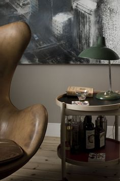 This Winged Leather Chair, Tray Table And Green Lamp Are Just Yummy.