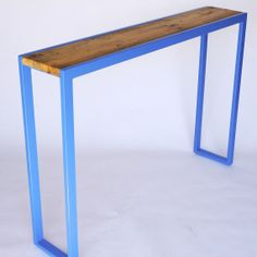 Solo Console Table with a reclaimed wood top and a never ending steel frame painted a bold blue