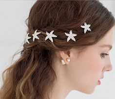 Add some rhinestone starfish to your hair. | 27 Ocean-Themed Wedding Ideas For People That Love Mermaids