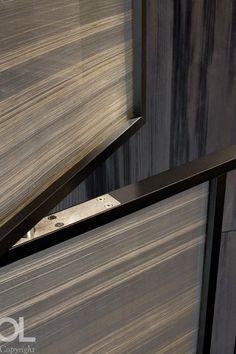 Media room hidden door into cupboards. mix of wallpaper and timber detail...