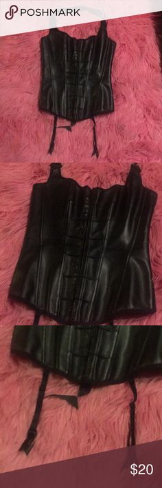 🌹Fredrick's🖤 faux leather corset bustier lingere This hottie comes equity with garter belts, square detailing along the hooks in the front, corset accent in the back, and a removable/adjustable neck strap. Perfect condition never worn. Works wonders as a top or lingerie. Fits true to size medium. Feel free to ask me any questions you have and don't be hesitant to make an offer. ❣️HAPPY POSHING🌹 Frederick's of Hollywood Intimates & Sleepwear Shapewear