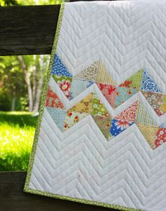 Zigzag Baby Quilt - the triangles are not pieced. just appliqued onto the white and sewed w/blanket stitch it looks like. want to try for a quick quilt, except for the actual quilting part!