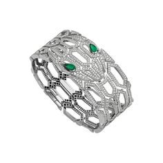 The Bulgari Serpenti Seduttori diamond bracelet  is made up of a mesh of hexagonal scales in 18 carat white gold, glittering with pavé diamonds, with two glinting pear-shaped emeralds for eyes. Discover the entry level Bvlgari jewellery: the Serpenti Seduttori diffusion collection, where the famous snake has shed its scales to reveal a more graphic look that hones in on the eyes. http://www.thejewelleryeditor.com/jewellery/article/bulgari-serpenti-seduttori-jewellery-review/ #jewelry