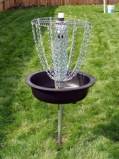 """Frisbee Golf Goal which my neighbor once saw used as a grill; imagine charcoal in the base and chickens in the """"net""""."""