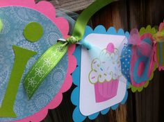 High Chair Cupcake Banner     I AM 1    Banner in PInk, Lime & Light Turquoise. $12.00, via Etsy.