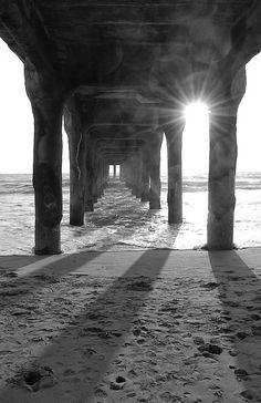 Sunburst Under the Pier - At Manhattan Beach, CA.