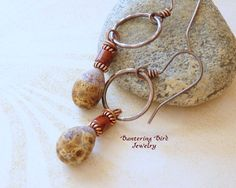 Artisan etched glass beads in earthy southwestern colors--neutral enough to wear with just about any outfit--form the drops in these one-of-a-kind hoop earrings. The hand-formed, darkened copper hoops were hammered for a bit of shimmer. ► 2 1/4 long, on secure handmade ear wires ► handmade, hammered copper hoops (5/8) ► artisan lampwork beads made by Raida Disbrow You can see these unique glass beads featured in another pair of my earrings here-- http://www.etsy.com/...