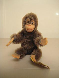 Steiff Vintage Jocko Chimpanzee  EAN 0020/11  Steiff Button/ and a white one  to make a pair