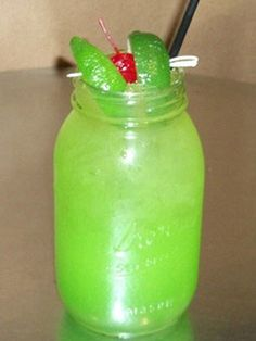 Toby Keith's 'swamp water'  -1.25 ounces wild shot silver  -2.23 ounces apple pucker  -.75 ounces simple syrup  -splash of midori  -fill with sweet and sour mix  -floate lime juice, garnish with two limes and a cherry  -add two drops of green food colring to darken green(optional)