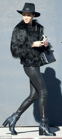 Babe: The natural beauty appeared to be makeup free for the outing and accessorised with a black handbag