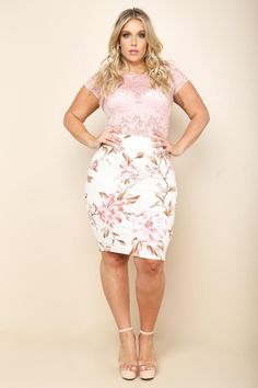 A plus size midi pencil skirt with an elasticized waistline. Features a back slit. Floral print all over.