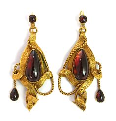 A pair of gold and carbuncle garnet set pendant earrings.  Sold for £1500