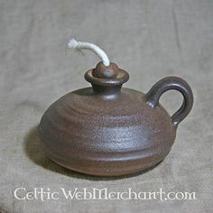 This handmade medieval oil lamp is based on originals that were used between the to century AD. This lamp is made of clay from the Rhinelands. Earthenwork from the Rhinelands was used all over Europe during the Middle Ages. Ceramic Pottery, Ceramic Art, Piano Lamps, Wrought Iron Decor, Pottery Workshop, Large Lamps, Antique Lighting, Antique Lamps, Lantern Candle Holders