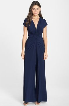 Free shipping and returns on Vince Camuto Twist Front Jersey Jumpsuit at Nordstrom.com. A neat front twist creates elegant dimension on the plunging V-neck bodice of a soft and stretchy jersey jumpsuit before giving way to the retro drama of the wide-leg silhouette. size 8 bell square