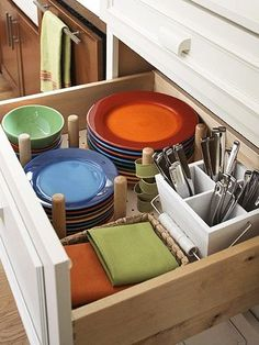 I like this idea - drawer for plates and silverware etc.   Good for my sweet almost 5' daughter - who can barely reach the first shelf :-)