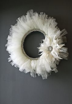 Wreath - Handmade ivory tulle and rhinestones with feather accent. Love this on the gray wall!
