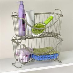Small Stackable Baskets for bathroom storage. The baskets' modular design allows multiple units to be stacked, maximizing storage space and a scooped front opening gives you easy access to stored items.