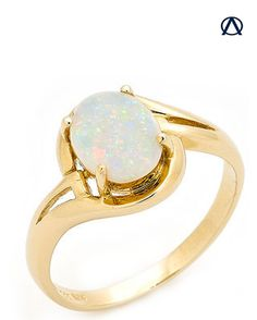 An adorable, yet classic ring with simple detailings on the 14k yellow gold band to complement the lovely Australian solid light opal sourced directly from Coober Pedy, South Australia.