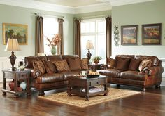 Hutcherson Harness Genuine Leather Sofa Set Sink in to the Hutcherson sofa set and relax in total comfort. Plush back and seat cushions provide optimal support while padded, rolled arms add extra softness and style. With rich leather in the seating area and DuraBlend® elsewhere, the Hutcherson makes for a luxurious yet affordable place to lounge. Decorative chenille pillows add touches of rich earth tones and some have a classic paisley pattern. *The sofa set consists of a sofa and a love…