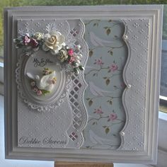 Spellbinders grand squares, dainty dots embossing folder, SB floral ovals, SB classic ovals, SB A2 bracket borders 1, The sentiment is from justrite 'ever after', the paper is a tilda pad called flower garden, and the dove embellishment is from annamarie designs.