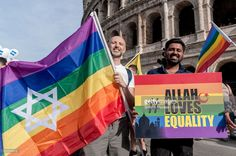 A Jewish demonstrator and demonstrator holds a banner reading 'Allah loves equality' during during the march in the streets demonstrating for civil rights, against violence and homophobia during The Gay Pride Parade (LGBT) on June 10, 2017 in Rome, Italy.