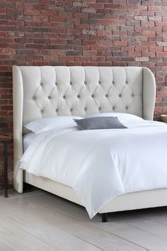 Carlotta, I like this one even better, I like the tufting and that that it doesn't have a footboard. I would prefer it to be lower, not a high bed.