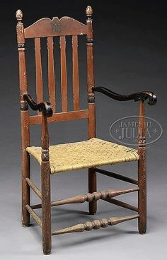 "RED PAINTED BANNISTER BACK ARMCHAIR. 	18th century bannister back armchair with turned posts, egg finials and scrolling arms. In a fine red and black finish over an older grey paint. SIZE: 44-1/2"" h."