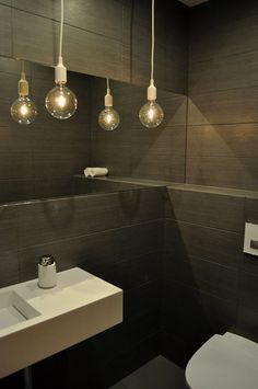 Guest toilet. Design by Nina Therese Oppedal. Not Only White wash basin designer Marike Andeweg.