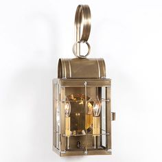"""The Double Wall Lantern by Irvin's Country Tinware is direct wired with two candelabra sockets, 60 watts max. This fixture is UL approved and has a 5 year guarantee. Dimensions: 20""""H x 7""""W x 6""""D."""