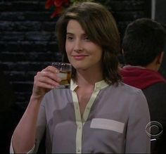 Robin's grey/mint contrast blouse on How I Met Your Mother.  Outfit details: http://wornontv.net/3544/