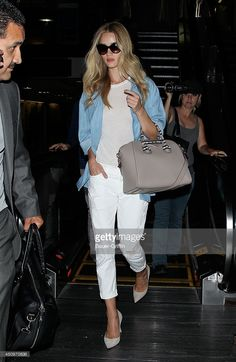 Rosie Huntington-Whiteley is seen at LAX on June 20, 2014 in Los Angeles, California.