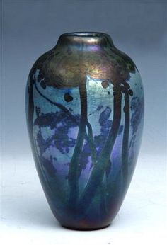 NORMAN STUART CLARKE (b. 1944)  An iridescent baluster shaped vase, of trees in a moonlit landscape, signed and dated '81 to the base